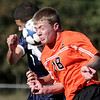 Peabody: Beverly High Schools Cam Jones and Peabody High Schools Shawn Bernardo collide as they both head the ball during their game in the first half of play at Peabody High. Photo by Mark Lorenz/Salem News