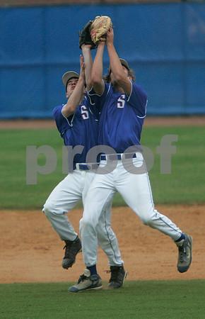 Lynn: Swampscott second baseman, Mike Gillis and first baseman, John Pelletier collide after Pelletier made the catch, in Division 3 North semifinals against Newburyport , at Frasier Field. Photo by Mark Lorenz/Salem News