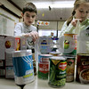 Peabody: Burke School fourth-graders, Philip Haley and Emily Bellavance pack up more food for their food drive in Fran Gallugi's class. The students collect weekly donations for Haven For Hunger. Photo by Mark Lorenz/Salem News