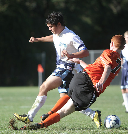Peabody: Beverly High Schools Conor Leahy tries to take down Peabody High Schools Nick Melo, during game in the first half of play at Peabody High. Photo by Mark Lorenz/Salem News