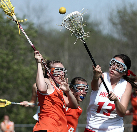 Middleton: Ipswich High Bryn Golesworthy and Mascos Elizabeth Iorio battle for the ball in lacrosse game at Masco. Photo by Mark Lorenz/Salem News
