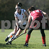 Beverly: Beverly High's Margaret Finn works around Waltham's Brianna Sorrentino in the first half, during the Division 1 North field hockey state tournament. Photo by Mark Lorenz/Salem News