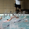 Danvers: Tony Padvaiskas head coach for St. John's Prep swim team , watches his swimmers warm up during their early morning workout at the Danvers YMCA. St. John's Prep are going for their fourth straight state swimming championship Friday night.Photo by Mark Lorenz/Salem News