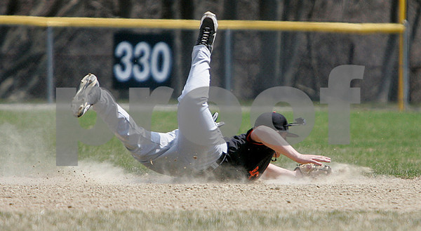 Beverly: Beverly's second-baseman, Pete Kallas grabs this line drive and makes the throw to first for the out, in game against Wakefield. Photo by Mark Lorenz/Salem Newsq