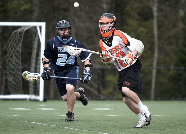 Beverly: Peabody High Buddy Kozinski and Beverly High Brendan Crowley go after a lose ball, in game at Endicott College. Photo by Mark Lorenz/Salem News