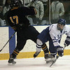 Salem: Danvers High's Chris Milne and  Lynnfield's John Festa get tangled in the first period, at Salem State. The two teams met in the Division 2 North state tournament preliminary round. Photo by Mark Lorenz/Salem News