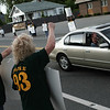 Beverly: From Left, Michelle Larcom, Mary Osbourne and Cathy McGowan, managers who support workers waive to cars, during a  protest outside of the Memorial Building, where the school committee is meeting. The protest is about them not wanting them to take away part-time workers health insurane benefits. Photo by Mark Lorenz/Salem News