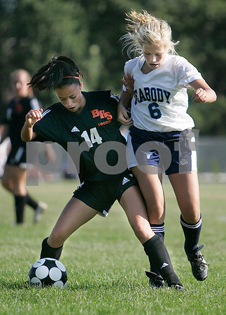 Peabody:  Beverly High School's Taylor Manzi battles for the ball against Peabody High School's Caitlyn Pinkham in the first half of play at Peabody High School. Photo by Mark Lorenz/Salem News.