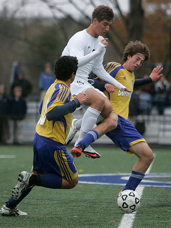Danvers: St. John's Prep, Grant Bean with gets tangled with two Acton-Boxborough's Dan Abbate and Bryce Rashbaum in the first half of play. Photo by Mark Lorenz/Salem News