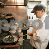 Danvers:Chef Matt Sanidas cooks one of his dishes during the grand opening of he and his wife's, Jean Sanidas restaurant, 9 Elm American Bistro's located at 9 Elm Street. There have been five new restaurants that opened int he downtown in the last year. Photo by Mark Lorenz/Salem News