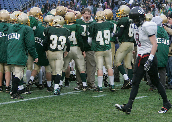 Foxboro: Marblehead Highs Alex Haigis walks by Bishop Feehan players as they celebrate in Div III Superbowl at Gillette Stadium. Photo by Mark Lorenz/Salem News