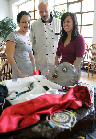 Beverly: Endicott College pastry chef, Ed Charest with students, Ashley Kenahan and Amanda Echteler with a coffin cake, that they helped him make. Photo by Mark Lorenz/Salem News
