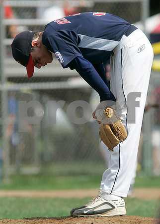 Bristol: Peabody West Austin Batchelor reacts after another hit by Rhode Island, in the New England Finals. Peabody defeated Rhode Island 11-7. Photo by Mark Lorenz/Salem News