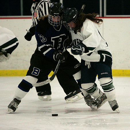 Hamilton: Pingree's Meaghan Souza and Berwick's Shannon Farrell, in EIL Hockey Finals. Pingree fell 5-4 in sudden death overtime. Photo by Mark Lorenz/Salem News