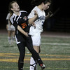 Peabody: Peabody High's Angela Ellison heads the ball against Newton North's Christina Callahan, in playoff game at Bishop Fenwick High School. Photo by Mark Lorenz/Salem News