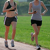 Beverly: Beverly High School cross-country captain, Alison Cookson and teammate, Liz Olson, during 800 meter workouts Friday morning. Photo by Mark Lorenz/Salem News<br /> , Beverly: Beverly High School cross-country captain, Alison Cookson and teammate, Liz Olson, during 800 meter workouts Friday morning. Photo by Mark Lorenz/Salem News