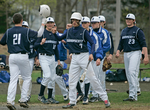 Marblehead: Swampscott celebrates as Sean O'Brien comes home scoring against Marblehead.  photo by Mark Teiwes