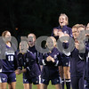 Danvers: Peabody High Schools soccer team cheers on their teammates after scoring against Danvers High School, Danvers High. Photo by Mark Lorenz/Salem News