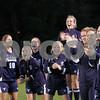 Danvers: Peabody High Schools soccer team cheers on their teammates after scoring against Danvers High School, Danvers High. Photo by Mark Lorenz/Salem News