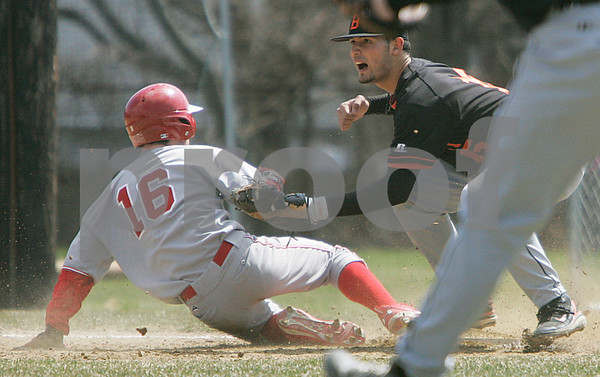 Beverly: Beverly's Felix Zamot awaits the call after tagging Wakefield's Anthony Lamattina on a throw from pitcher, Frankie Messina. Felix made the tag in time and made the out. Photo by Mark Lorenz/Salem News
