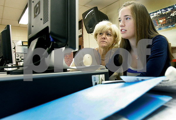 Peabody: Peabody High School teacher, Rosemary Slattery, works with senior, Katelyn Quealy, 18, in Geospatial Information System (GIS) class. This is a new class teaches kids to integrate data sets of information into maps of information. Photo by Mark Lorenz/Salem News