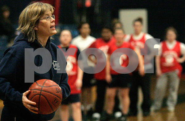 Middleton: North Shore Technical Regional High School girls basketball coach Maureen Robinson during practice. Despite going 0-19 in 2007, Robinson keeps a postive attitude and continues to be an influence to her players.  Photo by Mark Loenz/Salem News