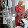 Swampscott: Lynne Rutkowski, goes through different styles of fabric, which she will use to make one of her signature aprons. The aprons are sold through out the U.S and Canada. Photo by Mark Lorenz/Salem News