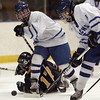 Salem: Danvers High's Kevin Curley gets tangled with Lynnfield's John Festa, as Danvers JD Hodgkins moves in on the puck in the Division 2 North state tournament preliminary round, at Salem State. Photo by Mark Lorenz/Salem News