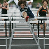 Ipswich: Hamilton-Wenham track star Jackson MacDonald in boys hurdle in meet at Ipswich High. Photo by Mark Lorenz/Salem News