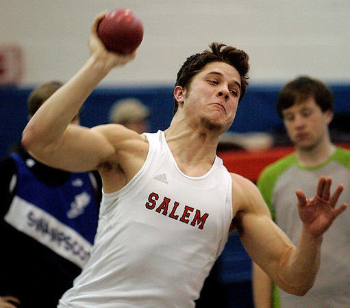 "Swampscott: Salem High's Josh Gillooly throws the shot put during meet against Swampscott. Matt's second throw was 37'8"". photo by Mark Lorenz/Salem News"