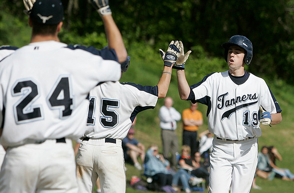 Peabody: Peabody High Joe Gruntkosky is greeted at home plate after hitting a 3 run home run, in game against Beverly. Photo by Mark Lorenz/Salem News