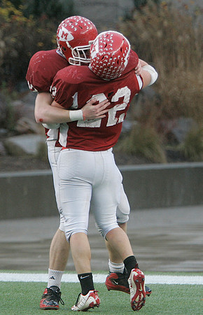 Foxboro: Masconomet High running back Evan Bunker celebrates with a teammate after scoring in Div IIA Superbowl against Marshfield, at Gillette Stadium. Photo by Mark Lorenz/Salem News