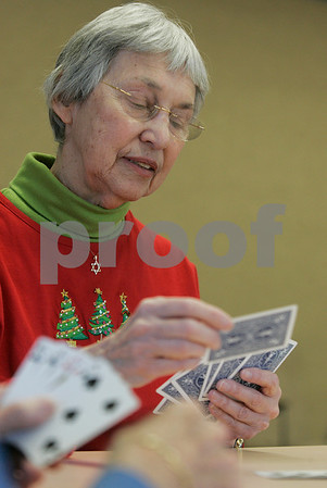 Beverly: Rosalyn Feinberg plays 500 Rummy with Bob Levesque at the Beverly Senior Center. The two are new the center and enjoyed a quiet day of playing music and cards. Photo by Mark Lorenz/Salem News
