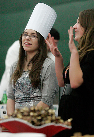Beverly: Corinne Ajemian, left, and Ellie Roccio, who  chat during the 2nd annual Bootstraps' Best Chef Competition held at Bass River Tennis Club. The two are volunteering at the event. Photo by Mark Lorenz/Salem News