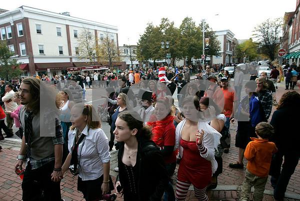 Salem: Halloween goers cross Washington Street onto Pedestrian Mall in Salem. Photo by Mark Lorenz/Salem News