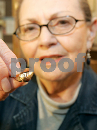 Peabody: Sonia Weitz of The Holocaust Center in Peabody, holds this ring, which was stolen from the center.  Photo by Mark Lorenz/Salem News