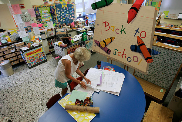 Beverly: Vickie Kenneally, a Hannah Elementary School second grade teacher, prepares her classroom for the start of school today. Photo by Mark Lorenz/Salem News<br /> , Beverly: Vickie Kenneally, a Hannah Elementary School second grade teacher, prepares her classroom for the start of school today. Photo by Mark Lorenz/Salem News