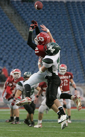 Foxboro: Masconomet High end Collin Burke cannot hang grab this pass  as Marshfield High linebacker, Sean Griffith is right on him, in Div IIA Superbowl against Marshfield, at Gillette Stadium. Photo by Mark Lorenz/Salem News