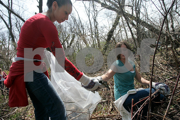Danvers: Angela Merluzzo and Kristen Sudati, employees at Cell Signaling Technology,take part in Earth Day Clean Up, this is the first annual Earth Day the company has sponsored.  About 20-25 employees were at hand along Trask Lane. Photo by Mark Lorenz/Salem News