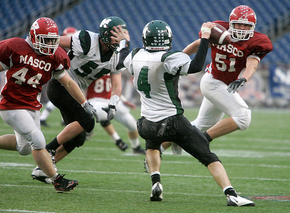 Foxboro: Masconomet defensive players, #44 Rob Grant and Tom Chub keep an eye on Marshfield quarterback, Steve Sousa in the second half of play in Div IIA Superbowl against Marshfield, at Gillette Stadium. Photo by Mark Lorenz/Salem News