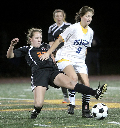 Peabody: Peabody High's Emily Manoogian and  Newton North's Amelia Williams battle for ball, in playoff game at Bishop Fenwick High School. Photo by Mark Lorenz/Salem News
