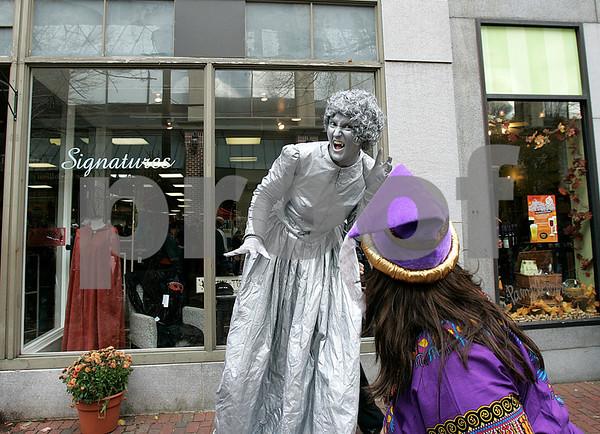 Salem: A street performer performs along Pedestrian Mall, during Halloween in Salem. Photo by Mark Lorenz/Salem News