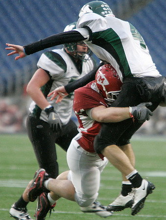 Foxboro: Masconomet defensive players, Rob Grant puts a hit on Marshfield quarterback, Steve Sousa in the second half of play in Div IIA Superbowl against Marshfield, at Gillette Stadium. Photo by Mark Lorenz/Salem News