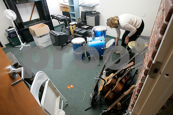 Salem: Assistant director at Branwen, Sue Guptill prepares to pack up musical instruments. Branwen a program for about 40 adults closed it's doors yesterday, as part of the state's budget cuts. Photo by Mark Lorenz/Salem News
