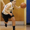 Peabody: Bishop Fenwicks Amy Pelletier drives up court in game against Danvers. Photo by Mark Lorenz/Salem News