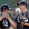 Beverly; St. John's Prep pitcher, Pat Connoughton high fives team mates in state tournament game against Beverly. Photo by Mark Lorenz/Salem News