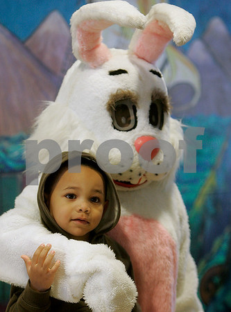 Salem: Rudy Rosario, 4, of Salem, takes in the scene at Nathaniel Bowditch School, while having his photo taken with the Easter Bunny, during the cities annual easter egg hunt. Photo by Mark Lorenz/Salem News