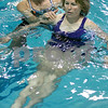 Salem: Carolyn Colby of Marblehead works with physical therapist assistant, Susan Finigan at the YMCA. Photo by Mark Lorenz/Salem News