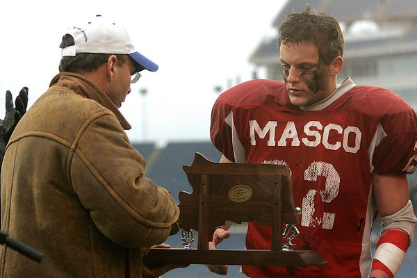Foxboro: Masconomet High Evan Bunker with trophy after losing to Marshfield in Div IIA Superbowl at Gillette Stadium. Photo by Mark Lorenz/Salem News