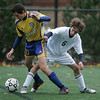 Danvers: St. John's Prep Andrew Jenkins gets tangled with Acton-Boxborough's Max Kashin, in the first half of play. Photo by Mark Lorenz/Salem News